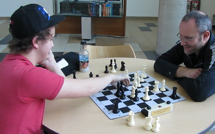 Troff plays chess after the tournament